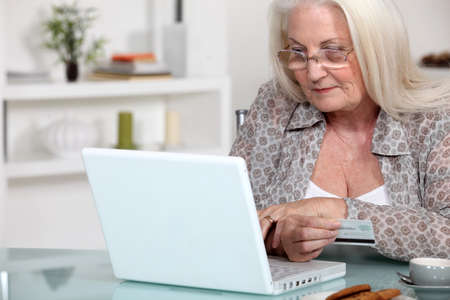 A mature lady doing online shopping. photo