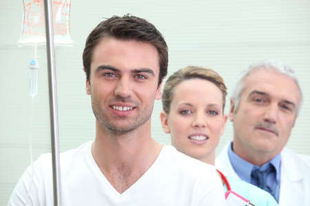a patient, a nurse and a doctor photo