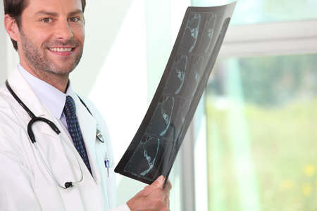 Male doctor holding x-ray image Stock Photo - 11612868