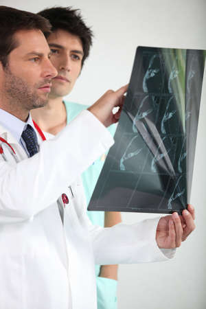 Two doctors looking at x-ray image photo