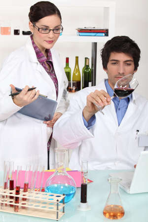 gastronome: Two scientist with wine in laboratory