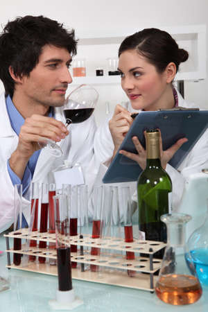 Oenologists analysing a wine photo