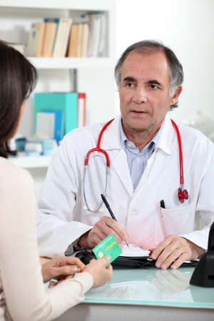 doctor giving pills: patient in the doctor