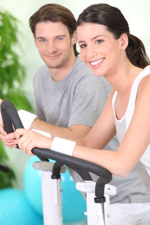 lean machine: Couple working out together at the gym Stock Photo
