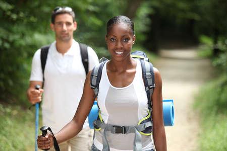 ramble: Couple hiking through the countryside Stock Photo