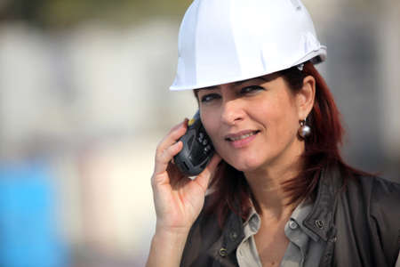 Woman contractor on a construction site photo