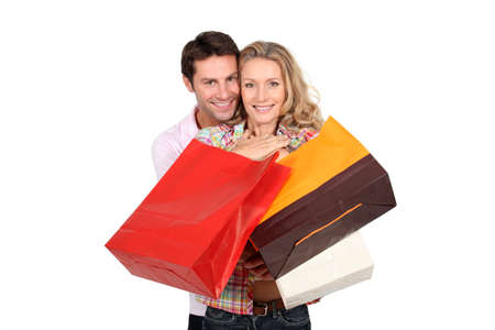 capitalism: Couple holding shopping bags