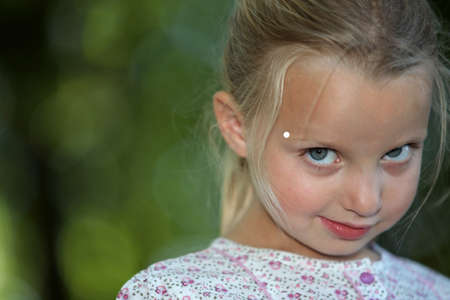 blonde little girl looking shy photo