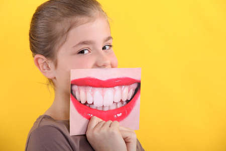 Child holding a picture of a smile Stock Photo - 11674378
