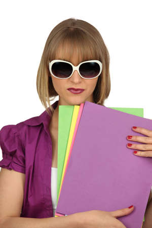 cagey: Woman with files and oversized sunglasses
