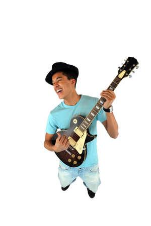 Young man playing a guitar photo