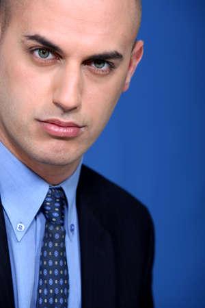 presuming: Bald young businessman