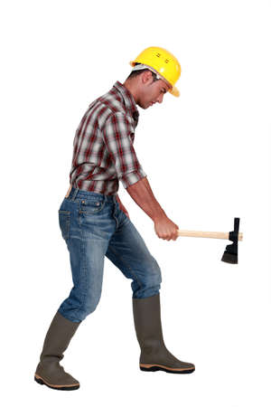 Tradesman using an axe to cut wood Stock Photo - 11674613