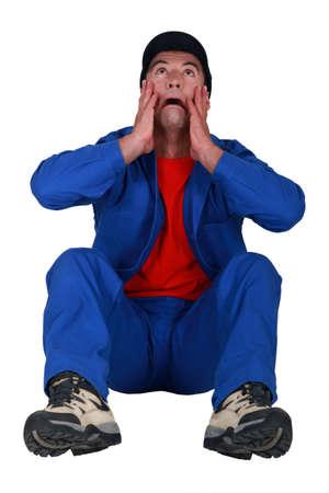 breakdown: A crying handyman. Stock Photo