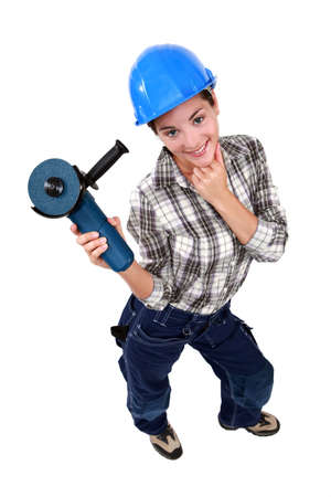 sexy craftswoman holding an electric saw photo