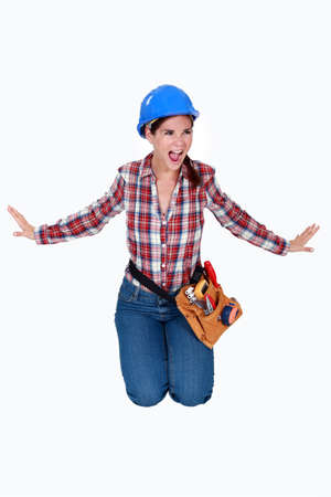 An angry female construction worker. photo