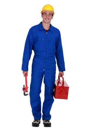 combination: Manual worker arriving at work Stock Photo