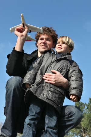 father playing with his son in the park photo