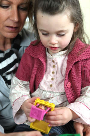 downcast: grandmother and granddaughter playing