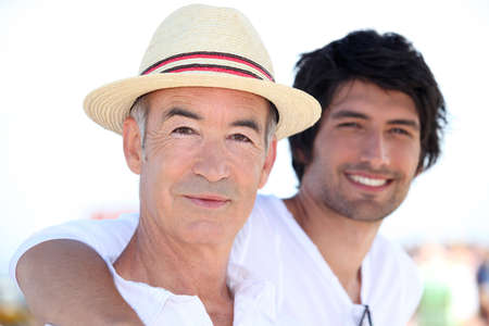 grown ups: father and son on vacation