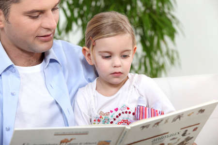 bedtime: father telling his daughter story