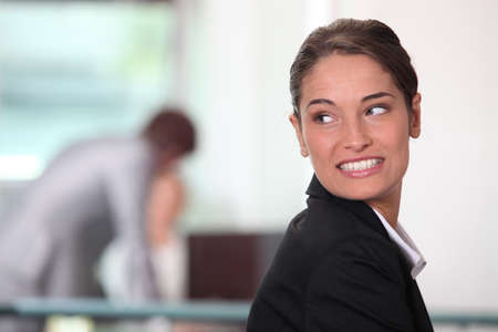 back up: Businesswoman smiling.