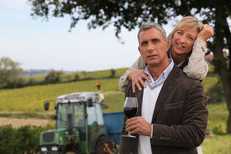 winemaker: couple of wine producers in front of vines Stock Photo