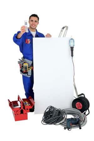 well equipped: electrician showing phone