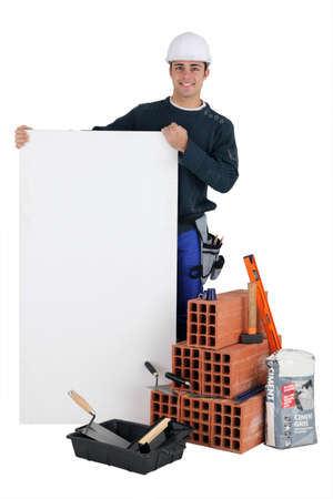 Bricklayer with a blank board Stock Photo - 11754578