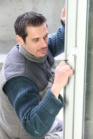double glazing: Manual worker fitting door