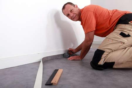 Man cutting carpet Stock Photo - 11755728