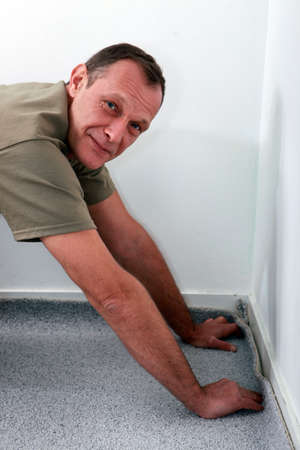 carpet and flooring: craftsman changing the carpet Stock Photo