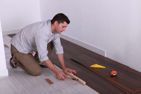 tidiness: craftsman putting a wood flooring Stock Photo