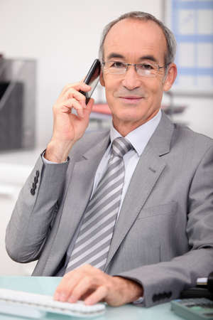 Senior executive on the phone Stock Photo - 11757305
