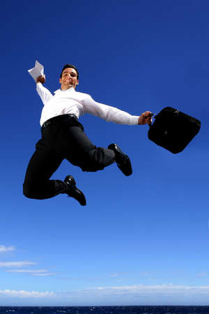 overjoyed: Overjoyed businessman jumping in the sky