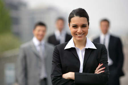 MEMBERSHIP: Business team lead by young brunette Stock Photo
