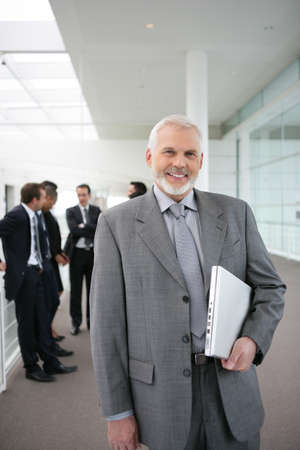 Senior businessman standing in a corridor Stock Photo - 11755042