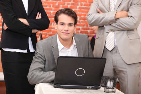 Smart young man at a laptop computer Stock Photo - 11756300