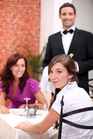Two female friends in restaurant photo