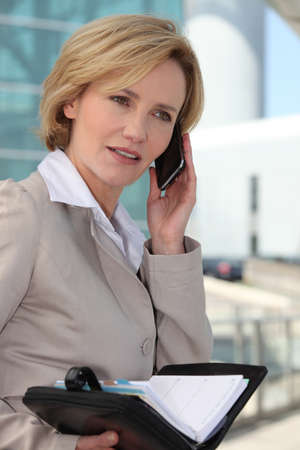 Businesswoman booking an appointment Stock Photo - 11756201