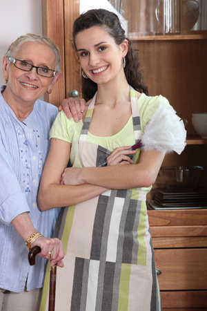 60 70: Young woman in an apron with an elderly lady