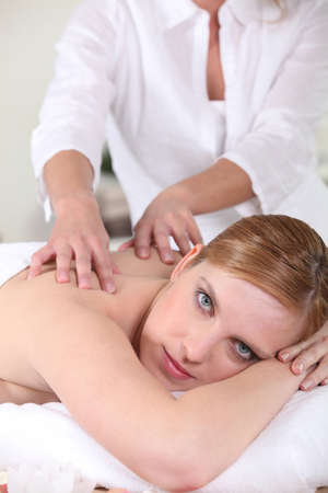 massaged: young woman being massaged