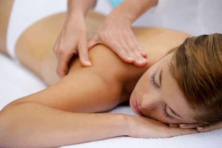 massage table: Girl having a back massage Stock Photo