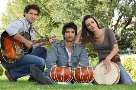 three musicians in a park photo