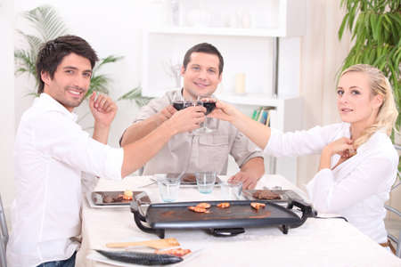 socializing: Friends having dinner at home