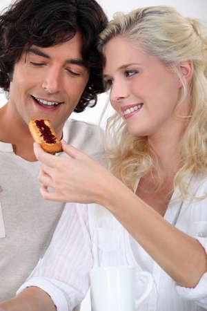 look pleased: Couple eating jam on toast