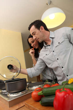 Couple cooking in a kitchen photo