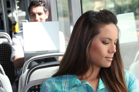 18 19: Girl sitting on the bus Stock Photo