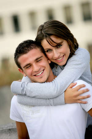 Couple hugging outside building photo