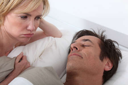 Wife unhappy at husband sleeping photo